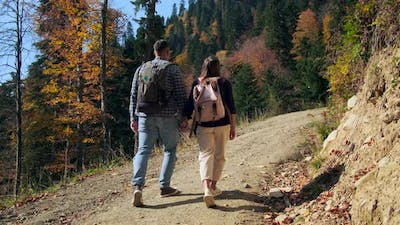 Man and Woman are Walking Together in Forest