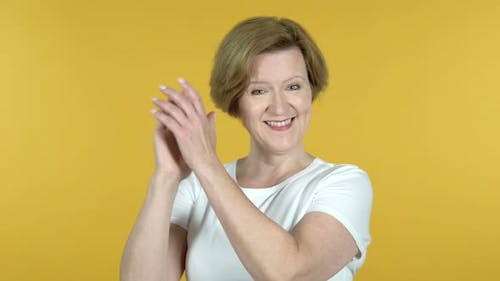 Clapping Old Woman, Applauding Isolated on Yellow Background