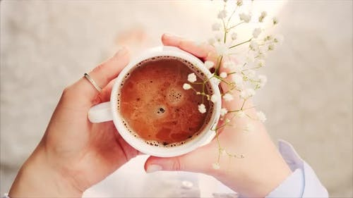 Cup of morning coffee or cocoa hot chocolate in a cozy atmosphere of home.