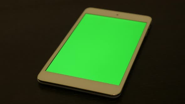 Modern silver PC tablet with green screen display 4K 2160p UltraHD footage - Silver tablet computer