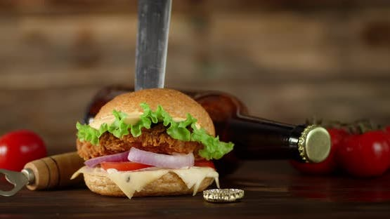The Burger with the Knife Stuck Slowly Rotates
