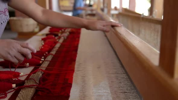 Thumbnail for Woman Weaving A Cloth On A Large Wooden Loom