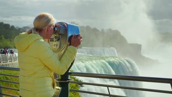 Thumbnail for A Woman Looks at Niagara Falls Through a Coin Operated Binoculars