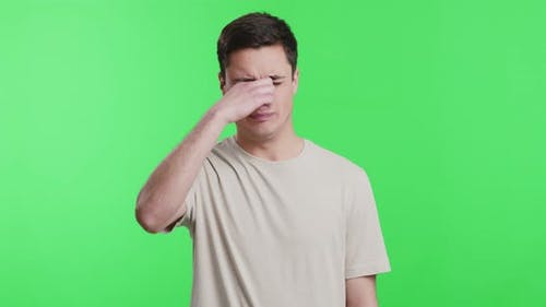 Discontent Guy Covering Nose with Hand, Smells Awful