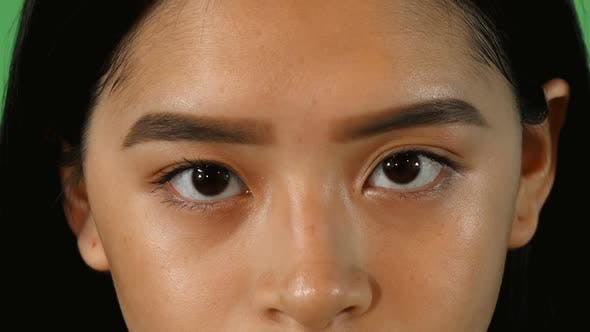 Thumbnail for Eyes of a Beautiful Asian Woman Looking To the Camera