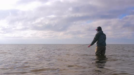 Fly Fishing For Sea Run Brown Trout Under Majestic Skies