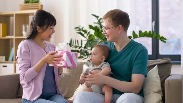Thumbnail for Happy Family with Gift and Baby Boy at Home 18