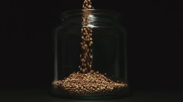 Thumbnail for SLOW MOTION:Brown Lentils Grains Pouring Into A Glass Jar