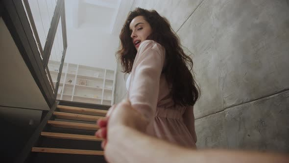 Thumbnail for Sexy Woman Holding Man Hand at Home. Cute Girl Tempting Boyfriend.