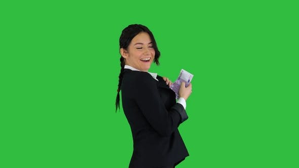 Cover Image for Confident and Happy Young Businesswoman Putting Money In