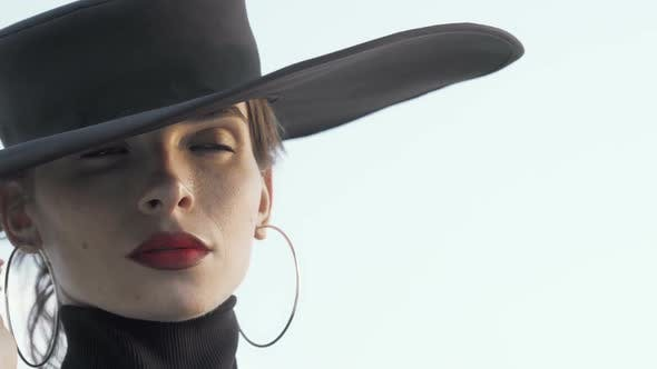 Thumbnail for Gorgeous Red Lipped Woman Wearing Black Hat Looking Away Thoughtfully