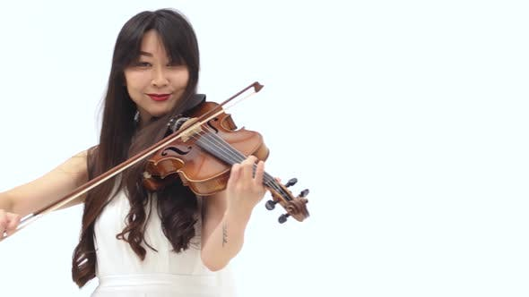 Thumbnail for Asian Woman Playing the Violin on a White Background. Close Up