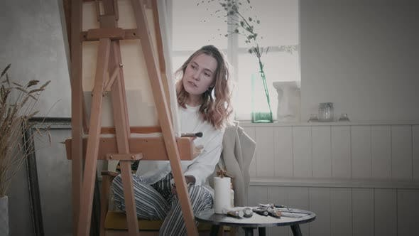 Female Artist Painting On Canvas