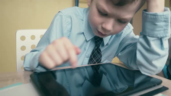 Thumbnail for CU, Tracking: Pupil Works on a Tablet Computer, Does Lessons, Flips Through Pages