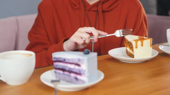 Thumbnail for Girl Is Breaking Off a Piece of Carrot Cake