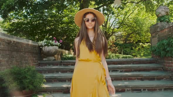 Thumbnail for Young Beautiful Girl in an Oculo and a Hat in a Park