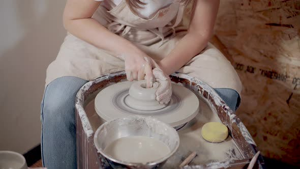 Sculptor Woman Is Modeling Clay on Potters Wheel in Studio, Close-up