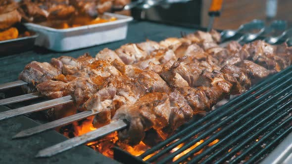 Thumbnail for Meat Grilled on Skewers on the Grill on the Street Market