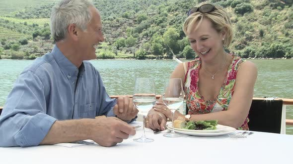 Thumbnail for Senior couple enjoying a glass of wine on a boat holiday