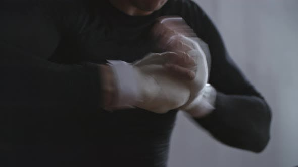 Thumbnail for Man Preparing Hands for Boxing Workout