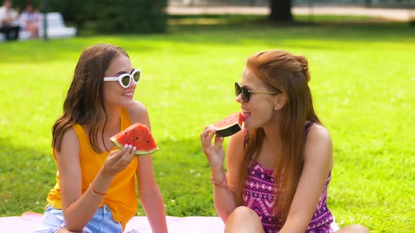 Thumbnail for Teenage Girls Eating Watermelon at Picnic in Park