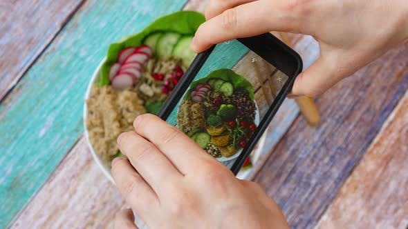 Thumbnail for Woman Taking Picture Of Vegan Food Using Smartphone. Healthy Buddha Bowl With Quinoa And Veggies.