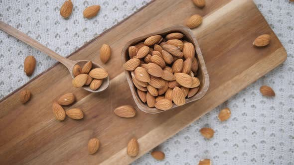 Thumbnail for Top View Of Almonds On Wooden Board. Almond Nuts In Wooden Bowl.