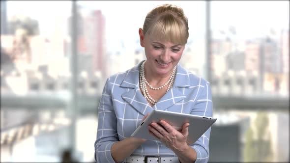 Elegant Woman Using Digital Tablet.