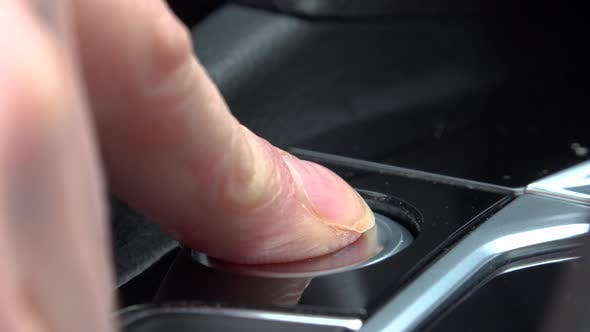 Thumbnail for A woman presses a Start-Stop Engine button in a car - closeup