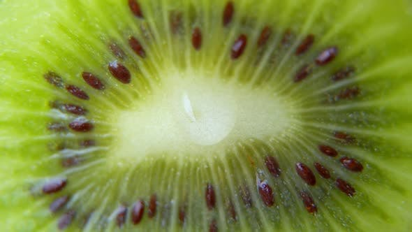 Thumbnail for Close-up of a Drop of Water or Juice Dripping From a Slice of Ripe Kiwi. Fruit Gives Off Freshness
