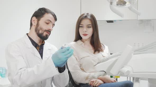 Attractive Young Woman Having Medical Appointment at Dental Clinic