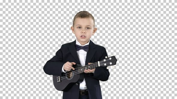 Boy in a costume walking and playing ukulele, Alpha Channel