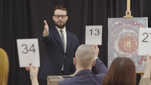 Thumbnail for Male Auctioneer Selling Contemporary Artwork at Auction