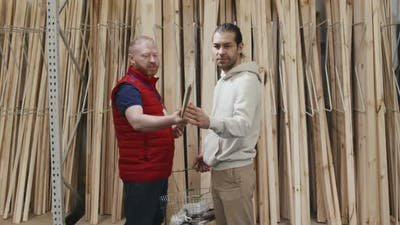 Male Hardware Store Worker Helping Customer