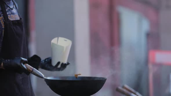 Street Food. Chef Cooking Thai Meal In Wok On Fire Outdoors