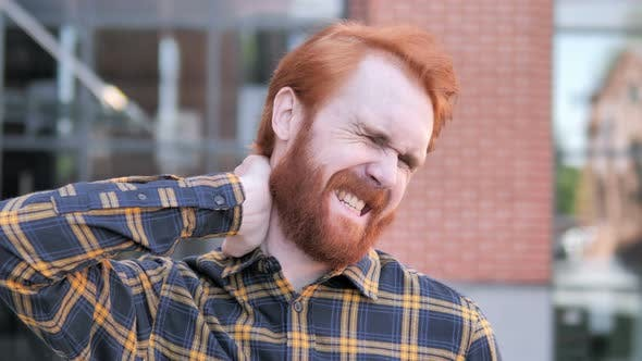 Cover Image for Tired Redhead Beard Young Man with Neck Pain