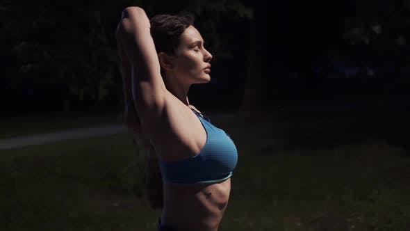 Thumbnail for Athlete in Sportswear Warmed Up Before Jogging in the Evening Park