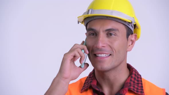 Face of Young Happy Hispanic Man Construction Worker Talking on the Phone
