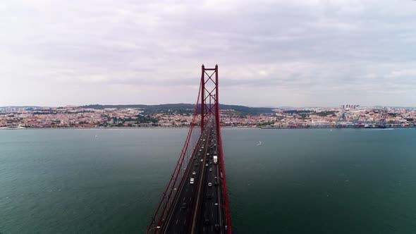 Thumbnail for Cars Drive Along Long Red Ponte De April Lisbon Bridge