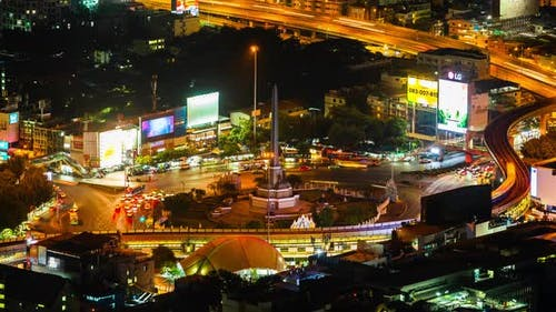 time lapse of Victory monument in central transportation at night in Bangkok, Thailand