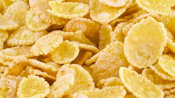 Thumbnail for Shooting of a Pile of Corn Flakes Rotating on the Turntable. Isolated on White Color Background. .