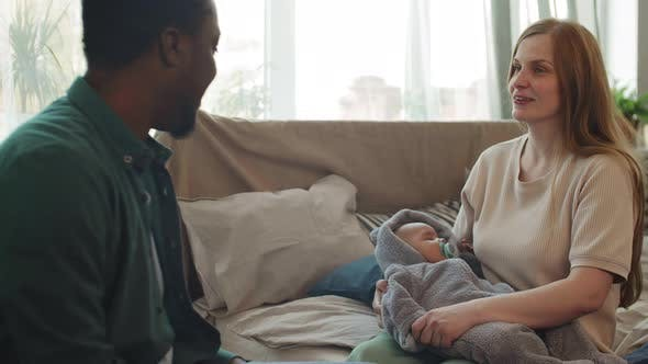 Thumbnail for Multiethnic Parents Rocking Their Baby to Sleep
