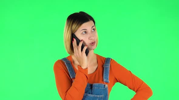 Cover Image for Girl Angrily Speaks on the Phone, Proves Something. Green Screen