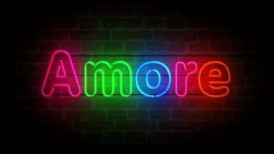 Amore love symbol neon on brick wall loop