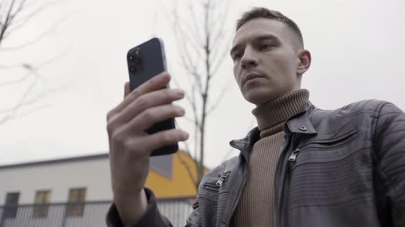 Man holding new beautiful smartphone