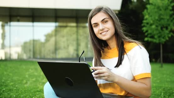 Thumbnail for Portrait of Woman with Laptop Working Outdoors