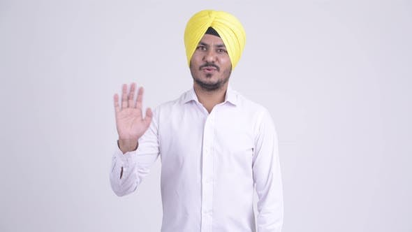 Thumbnail for Happy Bearded Indian Sikh Businessman Waving Hand