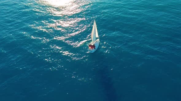 Thumbnail for Aerial View. Yacht Sailing on Opened Sea. Sailing Boat. Yacht From Above. Yachting at Windy Day. The