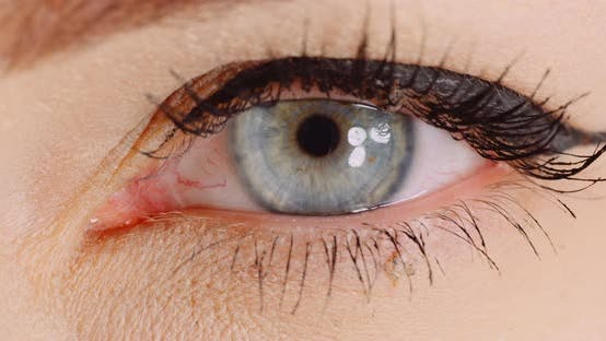 Thumbnail for Macro Shot of Blue Eye Opening Human Iris. Womans Eye