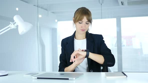 Thumbnail for Young Female Using Smartwatch at Work in Office